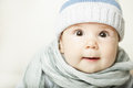 Small baby in blue cap cute face Stock Photo