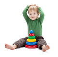 Small baby with a toy pyramid Stock Photos