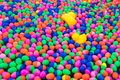 Small ball and yellow rubber duck in the water for playing games. Royalty Free Stock Photo