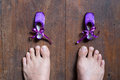 Small ballet shoes and big feet Royalty Free Stock Photo