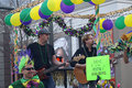 Small band playing in mardi gras parade plays music riding on a float public Stock Photography