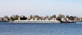 Small barge steaming through norfolk virginia harbor this is a town pointe park in downtown on beautiful blue water Stock Photography