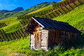 Small barn on alps mountains background Stock Images