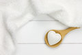 Small bath bomb in heart shape on wooden spoon Royalty Free Stock Photos