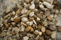 Small beach stones and sand river background texture made of Royalty Free Stock Photos