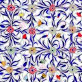 Small beautiful flowers with leaves on light background. Bright cornflowers in check seamless pattern. Watercolor painting.