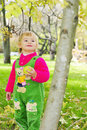 Small beautiful girl on green herb by autumn Stock Photos