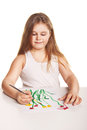 Small beautiful girl paints flowers over white Royalty Free Stock Photo