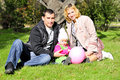 Small beautiful girl with parent on green glade Royalty Free Stock Image