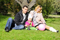 Small beautiful girl with parent on green glade Royalty Free Stock Photo