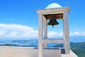 Small belfry with an old bell high above sea and land watching over the island of lefkada in greece Stock Photos
