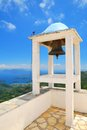Small belfry with an old bell watching over the island of lefkada in greece Royalty Free Stock Images