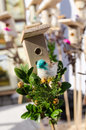 Small bird house handmade bird figure spring fair decoration wooden box and little colorful shape sold in outdoor easter market Royalty Free Stock Photo
