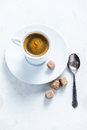 Small black coffee on marble table, from above Royalty Free Stock Photo
