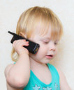Small blond boy cell phone in hand Royalty Free Stock Photography
