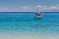 Small boat in the blue waters of ionian sea near agios nikitas village lefkada Royalty Free Stock Image