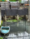 A small boat floating in polluted water in Bangkok