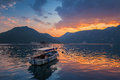 Small boat floats moored in kotor bay at dusk montenegro Stock Images
