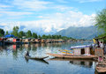Small boat on the lake in Srinagar, India