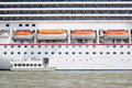 Small boat and large cruise ship in the harbor of venice Royalty Free Stock Photography