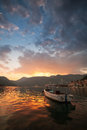 Small boat n perast bay of kotor montenegro floats moored in Stock Photography