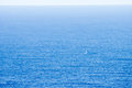 Small boat sailing in the atlantic ocean minimalistick shot Royalty Free Stock Image