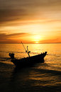 Small boat on a sea coast at the sunrise Stock Photos