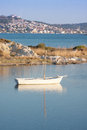 Small boat on a tranquil sea scene Royalty Free Stock Image