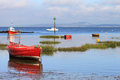 Small boats anchored Morecambe Bay at high tide. Royalty Free Stock Photo