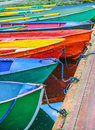 Small boats colorful parked to wooden pier Stock Images
