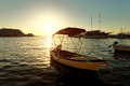 Small boats, fishing trawler and a sailboat moored in the harbor of a town Postira - Croatia, island Brac Royalty Free Stock Photo