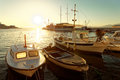 Small boats and a sailboat moored in the harbor of a town Postira - Croatia, island Brac Royalty Free Stock Photo