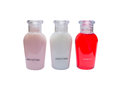 Small bottles of shampoo, conditioner and body lotion isolated Royalty Free Stock Photo
