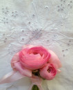 Small bouquet pink ranunculus ribbons eyelet fabric Royalty Free Stock Photos