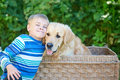 Small boy and cute dog in basket Royalty Free Stock Photo