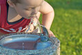 Small boy drinking fountain Stock Photo