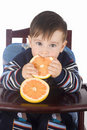 Small boy eats fresh grapefruit Royalty Free Stock Image