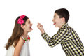 Small boy and girl tease one another show tongues gesturing isolated on white background Stock Images