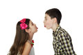 Small boy and girl tease one another Royalty Free Stock Photo