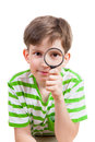 Small boy with magnifier glass on white background Royalty Free Stock Photo