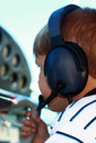 Small boy playing pilot in private aircraft Stock Photography