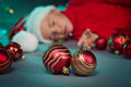 Small boy in santa hat sleep Royalty Free Stock Images