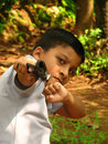 A small boy showing the gun. Royalty Free Stock Photo