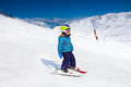 Small boy in ski mask and helmet skiing Royalty Free Stock Photo