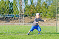 Small boy stretching to save a goal Royalty Free Stock Photo