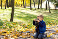Small boy using a vintage slr camera Royalty Free Stock Images