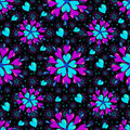 Small brightly colored hearts on a black background seamless pattern