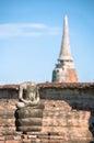 Small Buddha statue and ancient chedi at Wat Mahathat temple, Ayutthaya, Thailand Royalty Free Stock Photo