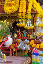 Small buddhism shrine with flowers decorated many sacrifices and Royalty Free Stock Photo