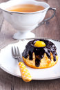 Small bundt cake with chocolate glaze and candied lemon and cup of tea Stock Images